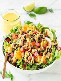 Grilled Caribbean Chicken Salad with 5 Minute Mango Dressing – Packed with juicy chicken, sweet oranges, black beans, and crunchy veggies. DELICIOUS, easy to make, and a fraction of the cost of restaurant salads! @wellplated