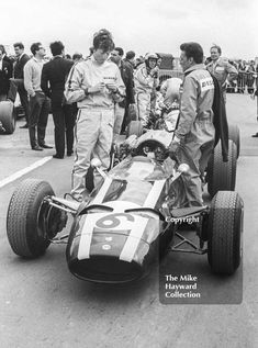 Jochen Rindt, Cooper Maserati V12 T81, and team mate Richie Ginther on the grid before the start of the Silverstone International Trophy, 1966.