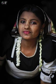 Myanmar Rohingya woman wears traditional clothes in a village Gollyadeil north of the town of Sittwe. DAMIR SAGOLJ/REUTERS  #world_cultures