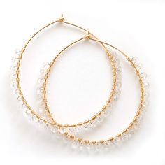 Handmade hoop earrings are wire wrapped with glittering, faceted white topaz gemstones. Available in 14 karat gold-filled or .930 Argentium silver in two stock sizes: Small - 1.5 inch (3.18 cm) diamet