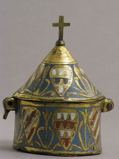 Pyx, that's a box that holds the communion bread.  1250-1300, made in Limoge, France.   Enamel on copper.