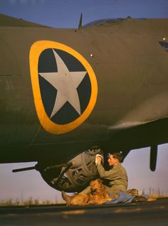 1942: Working on a bomber's ball-turret during World War II, England - Found via LIFE.com