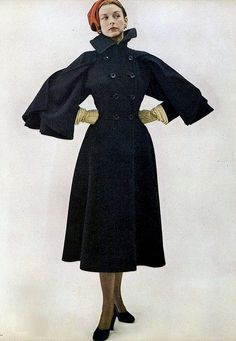 1947  wool coat with cape-sleeves by Claire McCardel late 40s black double breasted high collar princess style long full skirt