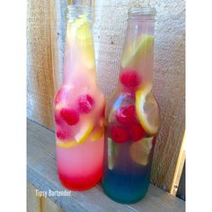 Tipsy Bartender Raspberry Lemonade Spritzer/Blue Raspberry Punch- raspberry vodka, citrus vodka, limoncello italian liqueur, lemon juice, grenadine, bubbly moscato, lemons, raspberries, blue curacao, lime, sweet n sour, sprite