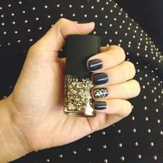 Navy or black polish with gold glitter on top :)