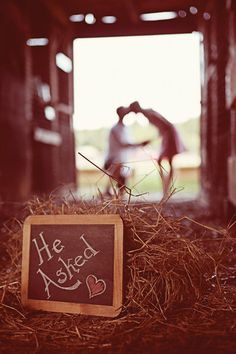 chalkboard message save the date with couple in the background out of focus. such a sweet photo!