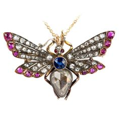 Victorian Ruby Sapphire Diamond Silver Gold Butterfly Necklace | From a unique collection of vintage necklace enhancers at https://www.1stdibs.com/jewelry/necklaces/necklace-enhancers/