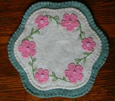 My own creation, pink spring flowers penny rug.