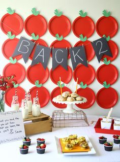 Delicious breakfast party to celebrate back to school with apple backdrop.