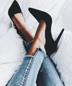 Chic black heels with casual denim jeans.