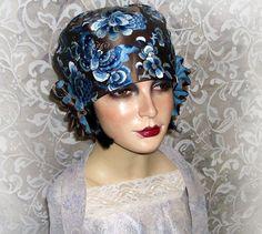 I used antique embroidered silk for this cloche.    Slide Album: Berti Borrell Couture Hats - Berti Borrell - Picasa Web Albums