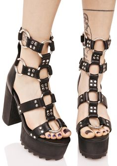 Current Mood Bondage Platform Sandals …oooh bb, you look good all tied up like that! Make 'em crawl in these ultra hott platforms, featurin' a smooth vegan leather construction, open toe, block heel 'N treaded platform, ultra strappy caged style with oversized O-ring connectors 'N silver studding, and zip back closure.
