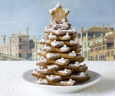 Bake and stack spiced cookies to create these adorable gingerbread Christmas trees. Gingerbread Christmas Tree, Christmas Tree Food, How To Make Gingerbread, Christmas Cookies, Christmas Recipes, Xmas, White Chocolate Ice Cream, Chocolate Brioche, Chicken On A Stick