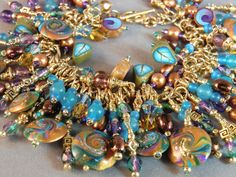 Susan Bailey of Turtle Soup makes wonderful swirled beads like these Mardi Gras colors--and you should see her other jewelry--it's fantastic!