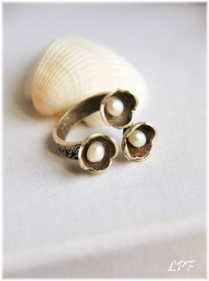 Pretty pearls... But set in silver ...  would be so great around a pearl dermal!