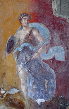 Fresco of Diana, the godess of the hunt, the moon, nature and childbirth. There are nearly forty structures in Pompeii that have (or had) depictions of her in one form or another.