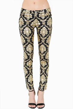 An ornate gold-toned pattern adds a regal touch to these stretchy twill skinnies. Allover damask pattern. Five pocket styling. Belt loops at the waist. Zip fly. Button front closure.