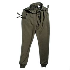 Silent Plinx sweatpant in Olive. this sweatpant is a perfect example of Damir Doma's style within design and also carries the sillhoette that Silent as a brand is most known for. The pant has a low crotch and a strict taper starting from the thigh and carrying to the cuff. Made with 100% premium heavy cotton the garment is perfect for winter and moves gracefully with your body.  #Silent #DamirDoma #Menswear #AW13