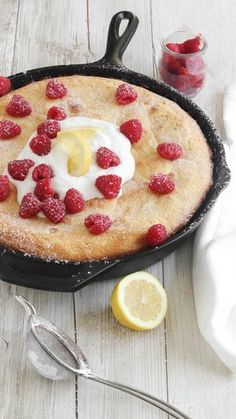 Lemon Custard Skillet Cake Welcome spring with this gooey cast-iron skillet cake topped with fresh berries whipped cream and a sprinkle of powdered sugar. Cast Iron Skillet Cooking, Iron Skillet Recipes, Cast Iron Recipes, Lemon Desserts, Just Desserts, Delicious Desserts, Yummy Food, Health Desserts, Funnel Cakes