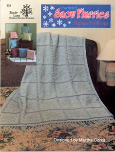 Snow Flurries Afghan and 7 Pillows crochet patterns. 7 different snowflakes are formed from the dropped dc as you crochet this afghan using only sc and dc.