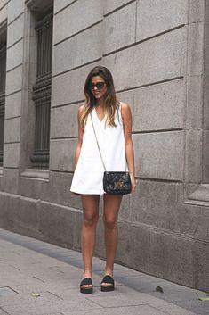 As simple as it gets. A white dress paired up with a black bag and black shoes ViaNatalia CabezasDress: Zara,Shoes: Steve Madden,Bag: Michael Kors,Sunglasses: Prada