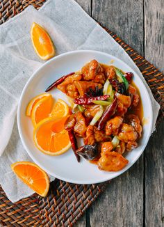 Orange Chicken, A Chinese Restaurant classic - - This Chinese restaurant style orange chicken recipe is better than sweet and sour chicken and uses a fresh orange, dried hot chili peppers, star anise, and dried tangerine peels. Chinese Orange Chicken, Baked Orange Chicken, Sweet N Sour Chicken, Chinese Food, Chinese Desserts, Baked Chicken, Orange Recipes, Asian Recipes, Ethnic Recipes