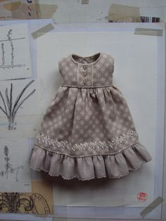 This dress is made from a lovely Tilda cotton in soft dove grey with a cute ditzy print. It has vintage lace detailing on the bodice and a plain