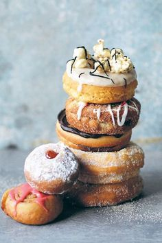 If you're planning to start your post-summer detox any time soon, look away now. The latest food trend dominating our Insta feeds is stacked desserts, and they're sure to get your sweet tooth's attention.  From pretty ice cream-filled macrons and towering doughnuts to milkshakes topped with cotton candy, whipped cream and sprinkles, we're not saying these should be a regular addition to your diet, but they sure are pretty.