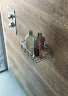 Wooden finish tiles for a warm feel in this showering area. VADO Notion valve and basket shown. www.vado-uk.com