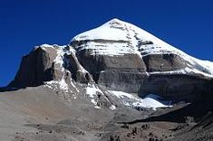 Click to enlarge -  Mount Kailash South Face shines beautifully in the mid-morning sun from the Inner Kora (09:13). At the bottom of the face is the Atma Linga, a pyramidal ice formation.