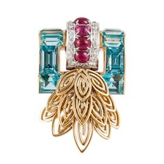 Yellow Gold Retro Pin,This striking retro pin is made of 14kt yellow gold. It features aquamarines, rubies, and diamonds.