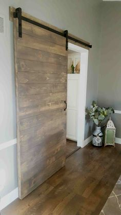 Hand made and stained interior horizontal plank sliding barn door. Hardware is included in price. Fits a standard size door opening of 40 inches or less. Diy Barn Door, Barn Door Hardware, Diy Sliding Barn Door, Door Hinges, Plank, Porte Diy, Barn Door Designs, Traditional Doors, Beach House Decor