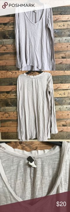 ⬇️EUC Free People Oversized Long Sleeve Cotton Tee Excellent used condition.  Ended up buying two in the exact same color by mistake.  Whoops!!!  Marked a size small, but will fit a size medium.  I am a 34DD chest and still have enough length to be able to wear with leggings.  Semi sheer, will need a tank or nude bra underneath. Free People Tops Tees - Long Sleeve