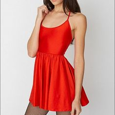 """AA Nylon Tricot Figure Skater Dress in poppy red Short, form-fitting, flirty dress featuring halter spaghetti ties and a breezy shirred skirt. Nylon tricot (80% nylon/20% elastane) is a stretchy, shiny fabric composed of that's very smooth and of medium thickness. 21.75"""" total length. Size M, but could also fit a small. Worn once and washed. This gorgeous poppy color is no longer sold on the AA site! Bundle for discounts. No ️️. American Apparel Dresses Mini"""