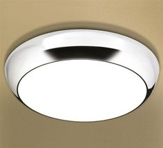 Shop the HIB Kinetic LED Ceiling Light .Features LED technology and is easy to fit. Chrome detail finish and round diffused shade adds a contemporary feel. Led Bathroom Lights, Bathroom Ceiling Light, Led Ceiling Lights, Bathroom Lighting, Electric Fireplace Suites, Wall Mount Electric Fireplace, Shower Lighting, Diffused Light, Light Fittings