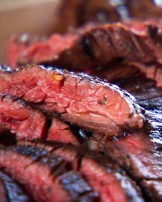 """Grilled Latin-Style Skirt Steak. If you're looking for a great steak dinner without breaking the bank, try marinating an inexpensive cut of meat. This marinade imparts a vibrant flavor with a distinctly Latin influence. Serve grilled onions and peppers alongside the steak. From the book """"Mad Hungry,"""" by Lucinda Scala Quinn (Artisan Books)."""