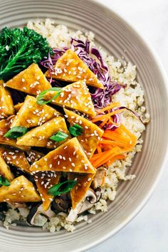 Teriyaki Tofu Bowl with Cauliflower Rice - This recipe combines protein, vegetables, and a delectable savory sauce for a healthier low carb dinner.
