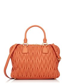 Getting one of our 5 a day with this papaya-hued Miu Miu handbag counts, right?