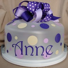 LOVE this cute gift: Personalize a plain cake carrier with initials, a name, or quote - be sure to include a luscious cake, too :)