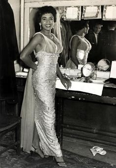 I hear that Dame Shirley Bassey will make her first appearance on the Academy Awards on February 24th. I can't wait to see that! Here, she is in her dressing room in London in May 1958, looking almost as good as she does today! Photo by Popperfoto/Getty Images.