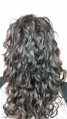 Deva waterfall cut. This is a great cut for long curly hair!