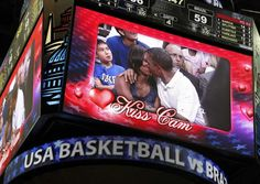 """President Barack Obama and first lady Michelle Obama are shown kissing on the """"Kiss Cam"""" screen during a timeout in the Olympic basketball exhibition game between the U. and Brazil national men's teams in Washington, July REUTERS/Jonathan Ernst Kiss Cam, Team Usa Basketball, Olympic Basketball, Michelle E Barack Obama, Presidente Obama, Mr President, Try On, Victorious, Olympics"""