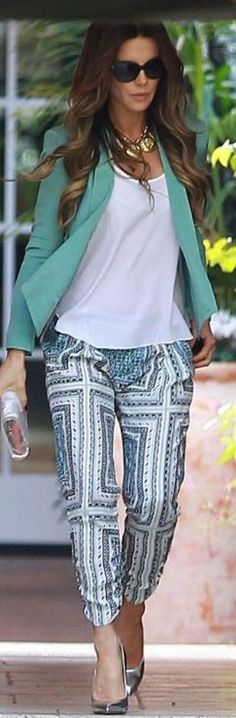 Who made  Kate Beckinsale's silver clutch handbag, mint green blazer, and print pants?