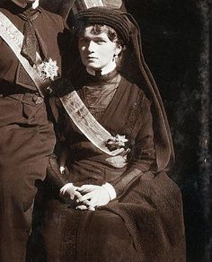 Grand Duchess Olga Nikolaievna Romanov. >some sort of formal dress (sash) - I am not familiar with this photo or where or when it was taken. Does anyone have any idea? :aPags
