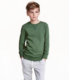 Green. CONSCIOUS. Sweatshirt in soft fabric with ribbing at neckline, cuffs, and hem. Cotton content is organic.
