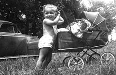 taking dolly for a ride.......Google Image Result for http://www.antiquedolls-collectors-onlineadvisors.com/images/pam-with-doll-in-buggy.jpg