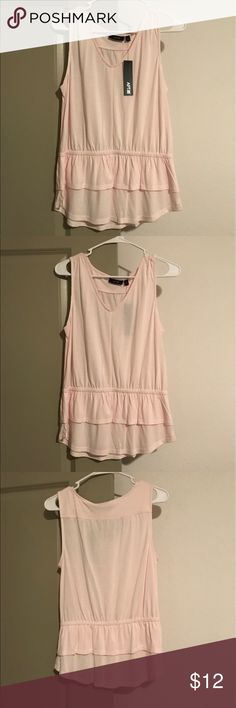 Ruffled Pale Pink Sleeveless Top Pale pink color. V neck. Has elastic waist with double lined ruffle on bottom. Comfortable and flattering look! Apt.9 Tops