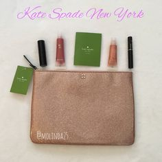 Kate Spade Gia Mavis Clutch 100% Authentic Kate Spade Gia Mavis Street Rose Gold Glitter Clutch. My iPad mini fits perfectly in this cute clutch. Material: PVC.  No trades or PP. Reasonable offers are welcome  Note: lip gloss, lip stick, mascara & iPad mini is Not included.  kate spade Bags Clutches & Wristlets