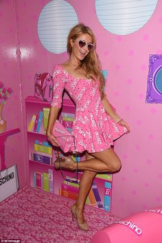 Come on Barbie let's go party! Paris Hilton wears baby pink Moschino by Jeremy Scott to a ...