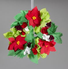 A poinsettia flower Christmas wreath made of nothing but paper napkins and a paper plate? Party City employees are so crafty!!
